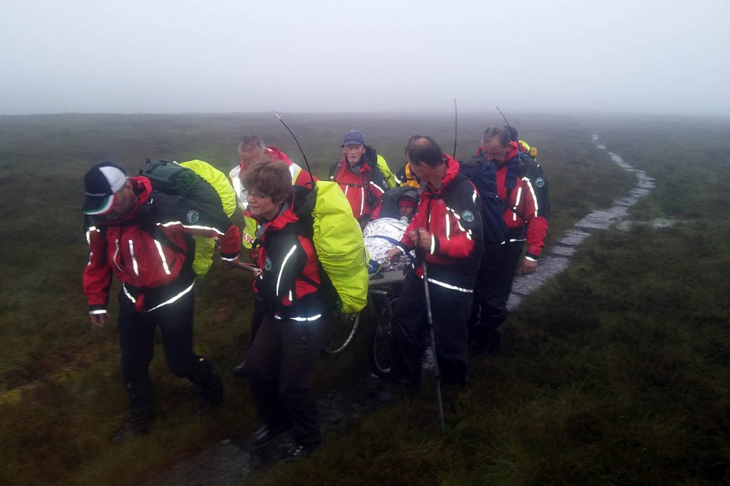 Rescuers stretcher the injured walker from the Pennine Way. Photo: BSARU