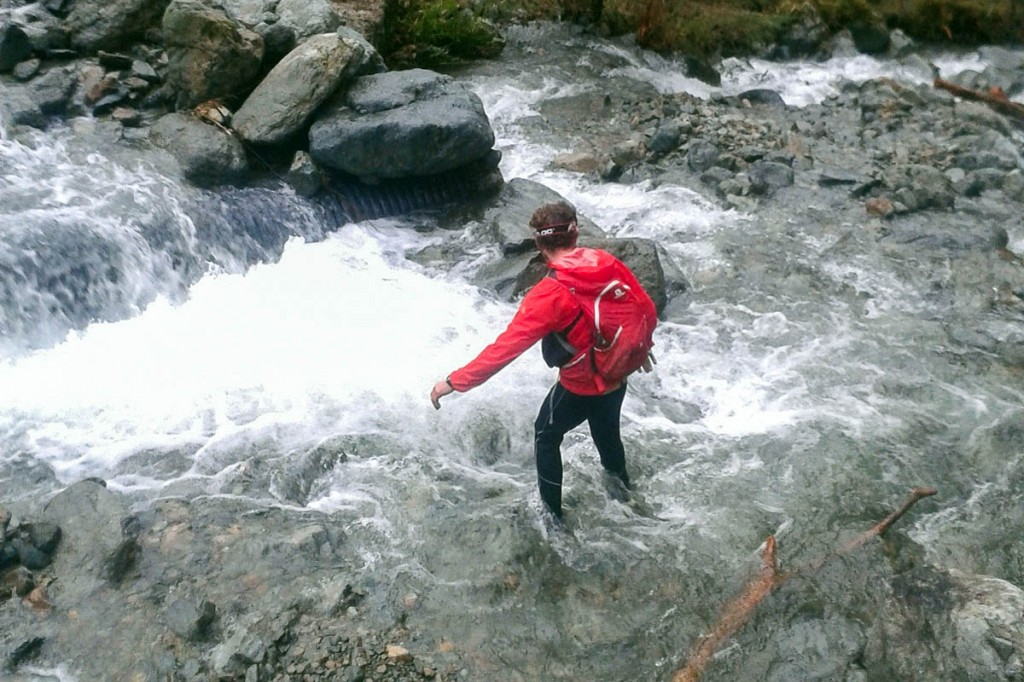 Duncan Buchanan tackles a swollen river