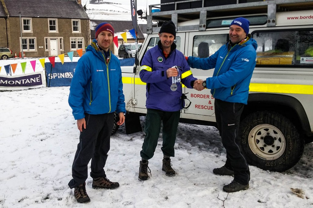 BSARU teamleader Stuart Fuller-Shapcott is presented with a special Spine Race finishers' medal in appreciation of the team's efforts. Photo: BSARU