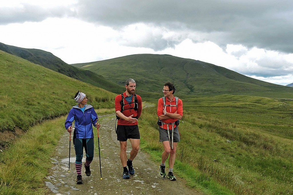 Sabrina Verjee discusses routes with Paul Tierney, centre, and Steve Birkinshaw after summiting Clough Head