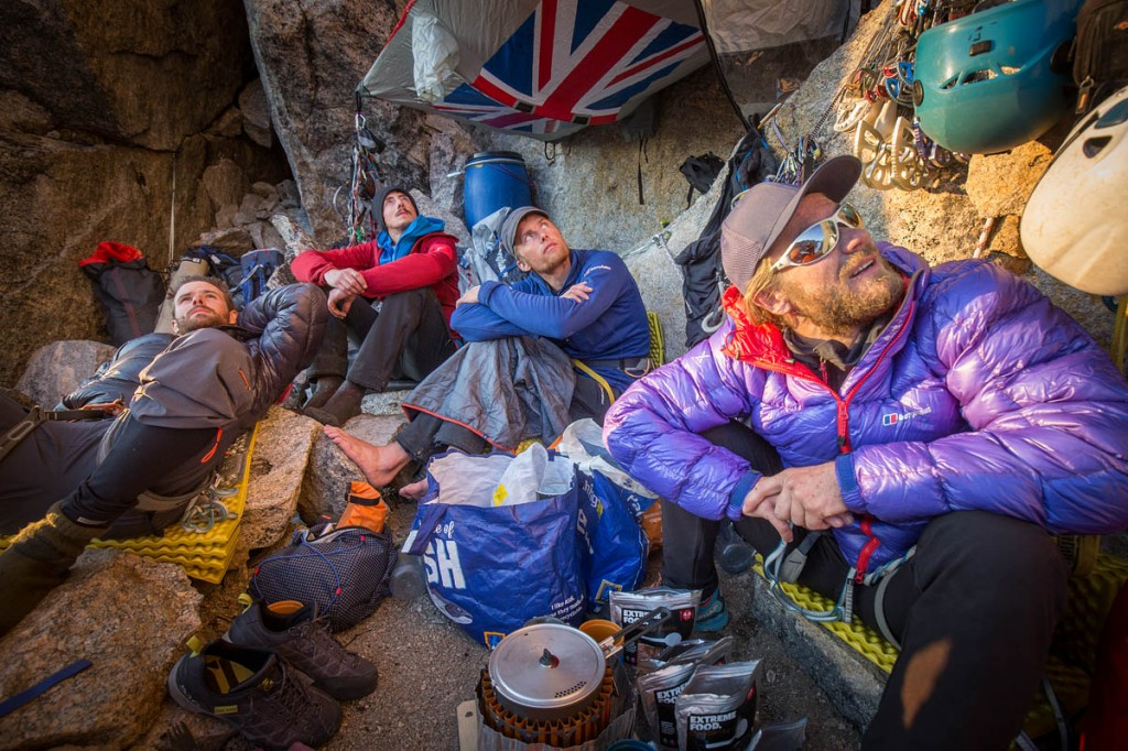 The team plans where to go next as they prepare their dinner in the Arctic Hotel. Photo: Matt Pycroft/Coldhouse Collective