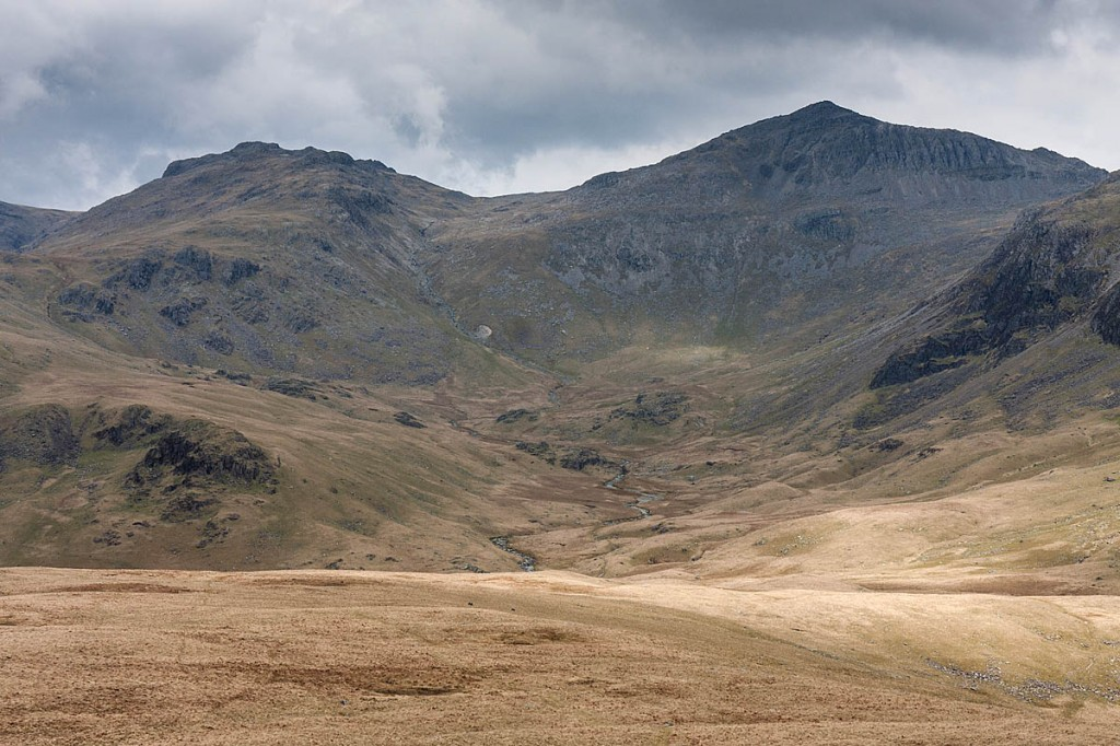 The walker was found 'in the middle of nowhere' after heading for Bowfell, right. Photo: Bob Smith/grough