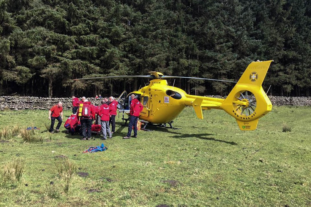 Rescuers stretcher the injured rider to the air ambulance at Gisburn Forest. Photo: Bowland Pennine MRT