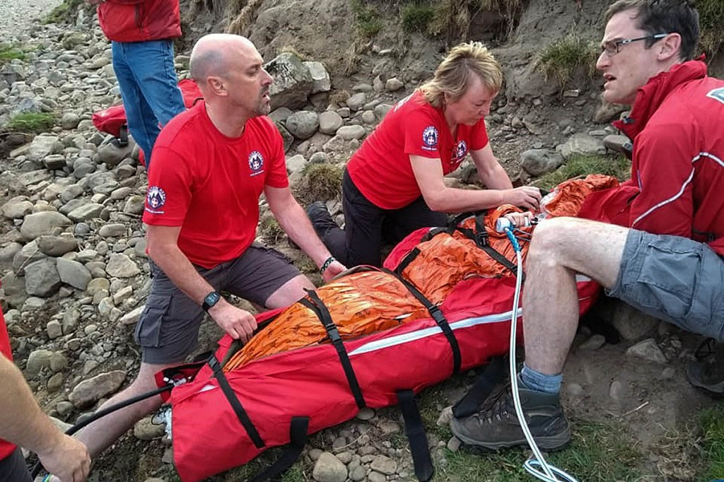 Rescuers at the scene on the riverbank. Photo: Bowland Pennine MRT
