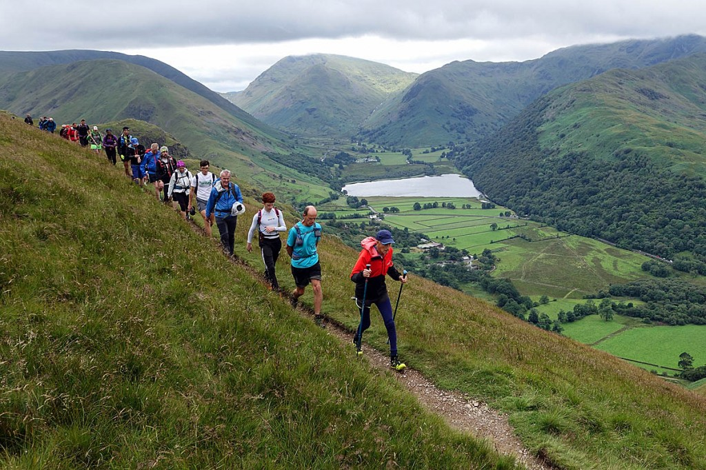 Joss Naylor heads a line of supporters on the descent into Patterdale. Photo: Scott Umpleby/Brathay Trust