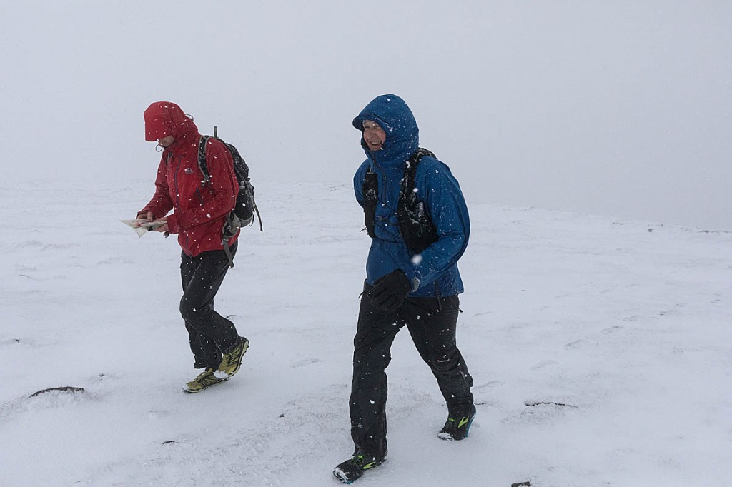 Brian Melia and his pace runner battle winter conditions on the summit of Ingleborough on the final day of his A Pennine Journey run. Photo: Bob Smith/grough