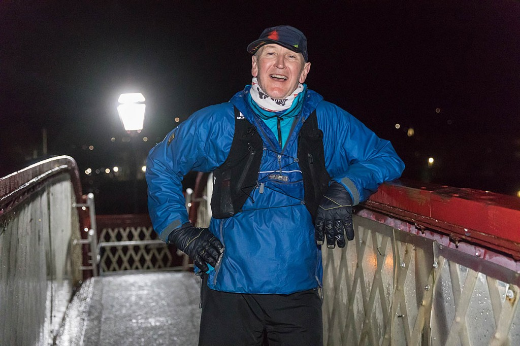 Brian Melia stands on the footbridge of Settle station at the end of his A Pennine Journey run. Photo: Bob Smith/grough