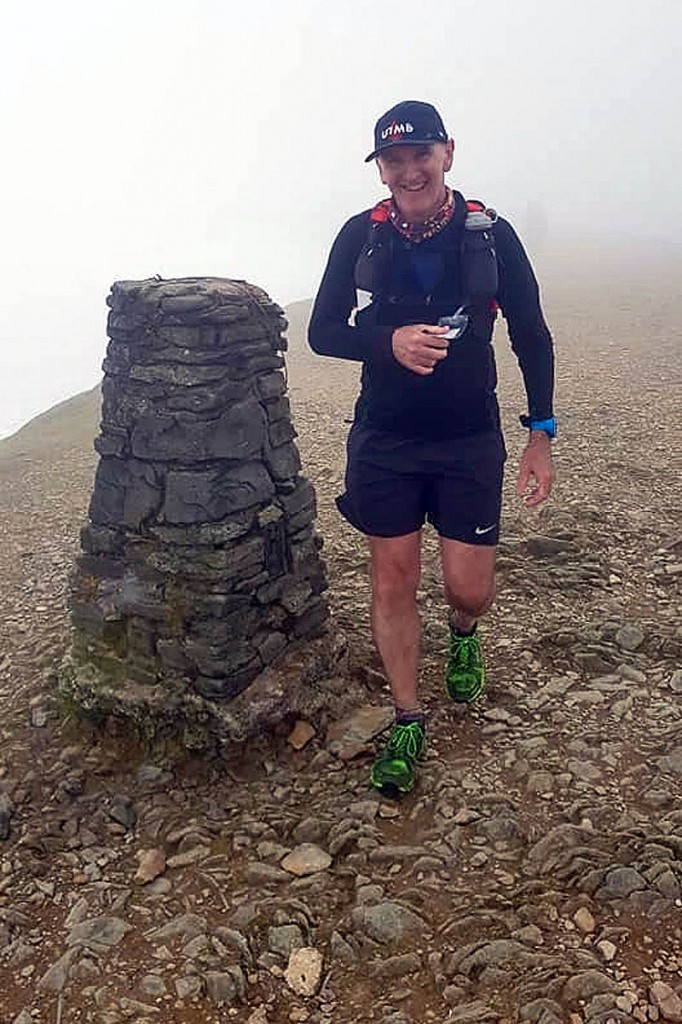 Brian Melia at the summit of Helvellyn during the Lakes Mountain 42
