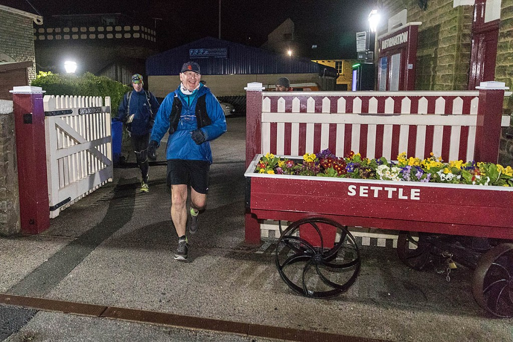 Brian Melia arrives at Settle railway station at the end of his successful continuous run of A Pennine Journey. Photo: Bob Smith/grough