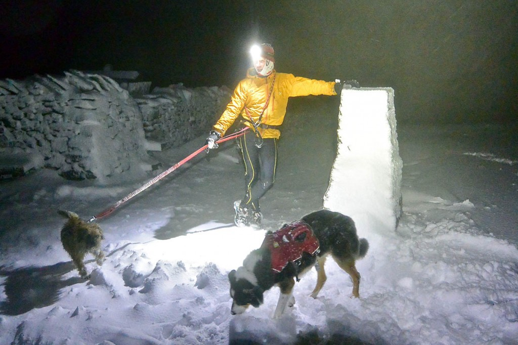 Brian Stallwood on the summit of a wintry Pen-y-ghent with his two dogs