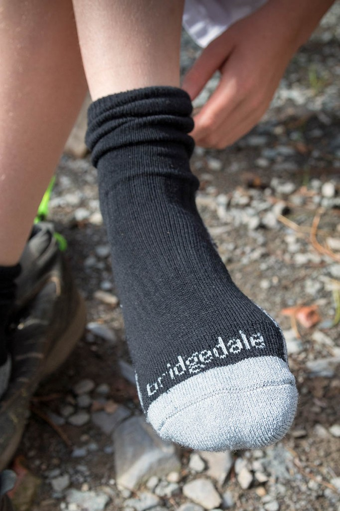 A young Outward Bound visitor tries on the Bridgedale socks. Photo: Gary Short