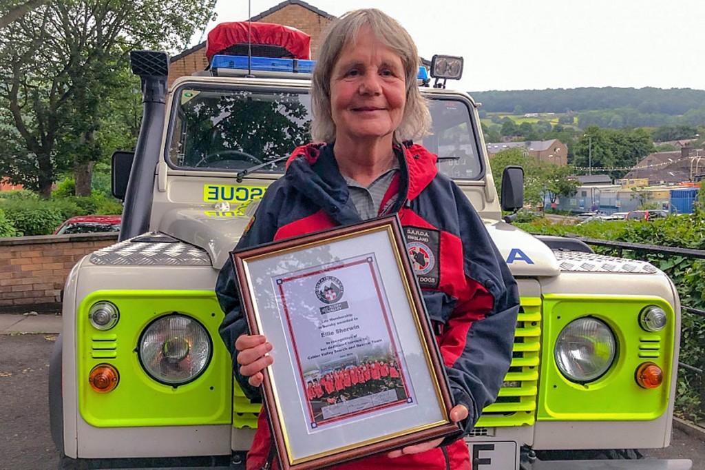 Ellie Sherwin displays her award