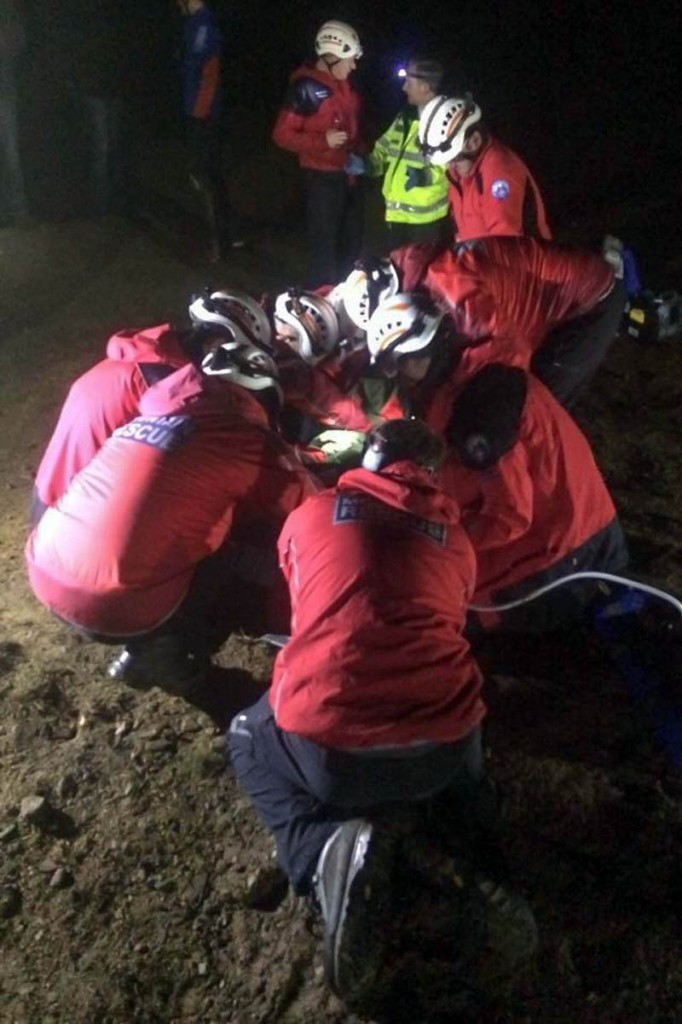 Rescuers tend to the injured mountain biker. Photo: Calder Valley SRT