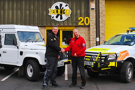 Al Day of the rescue team receives a cheque for £400 from Kevin Baldwin, right, of Mud UK