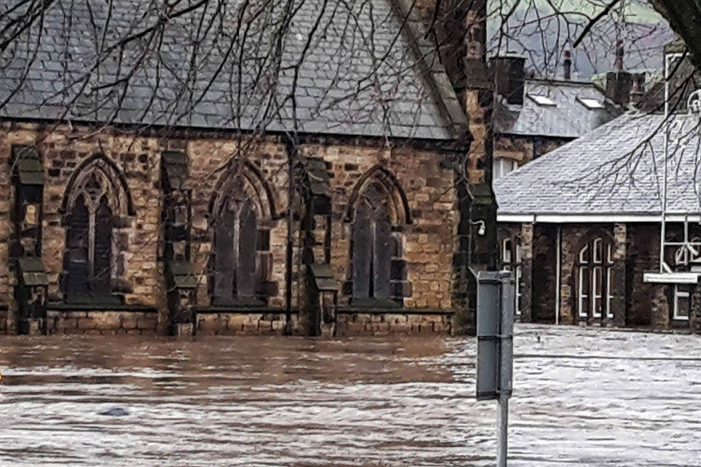 St Michael's Church and its neighbouring hall were badly flooded on Boxing Day. Photo: Calder Valley SRT