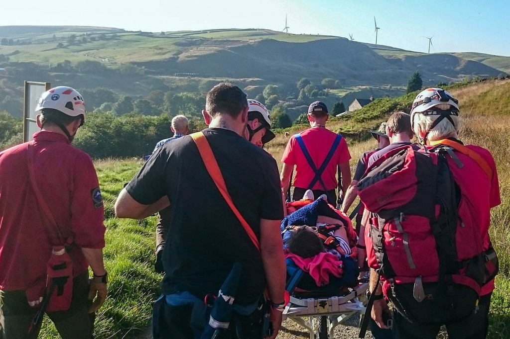 Rescuers stretcher the injured walker from the scene. Photo: Calder Valley SRT