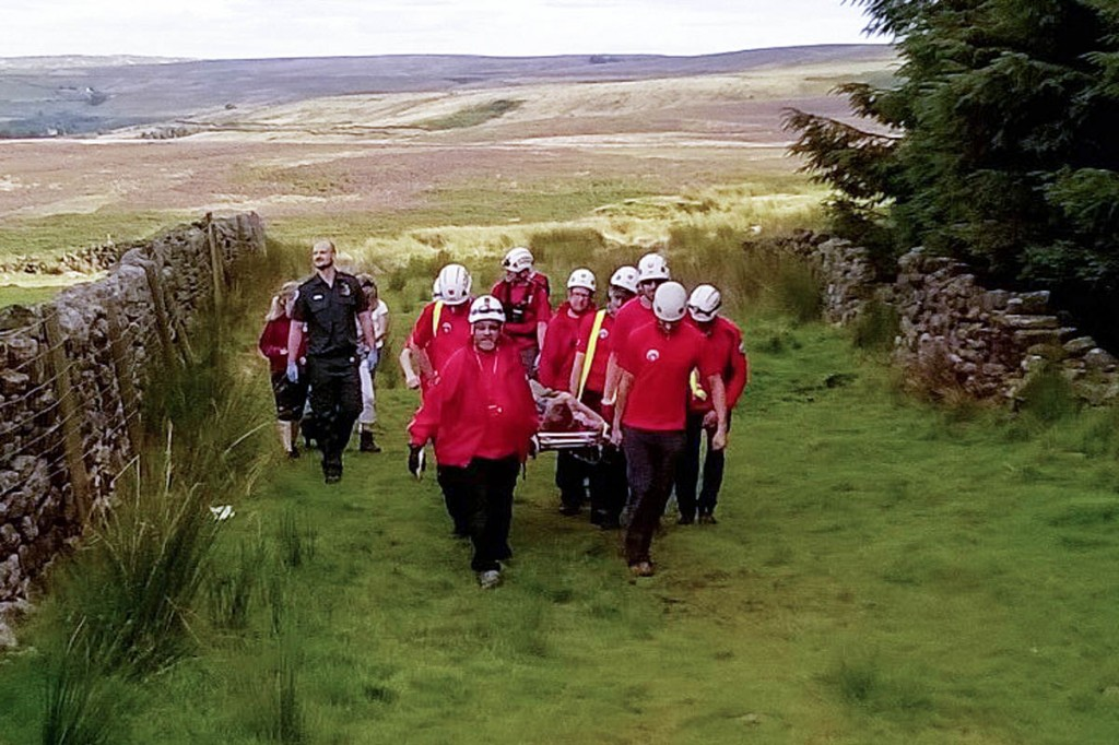 Rescuers stretcher the walker from Brontë Falls. Photo: Calder Valley SRT