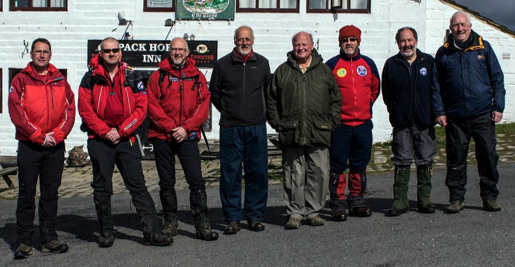 Eight team leaders, past and present, joined the walk. From left, cronologically: Malcolm Proctor, Pete Smith, Pete Farnell, Dave Kingham, Graham Astley, Mick Smith, Al Day and current team leader Ben Carter. Photo: Calder Valley SRT