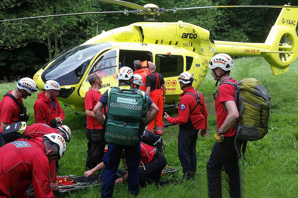Rescuers with the air ambulance at the scene. Photo: Calder Valley SRT