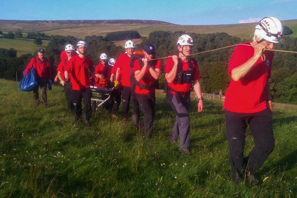 Team members stretcher the injured walker from the scene. Photo: Calder Valley SRT