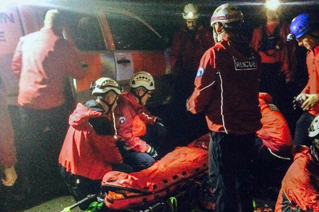 Team members with the injured cyclist at Lumb Bank. Photo: Calder Valley SRT