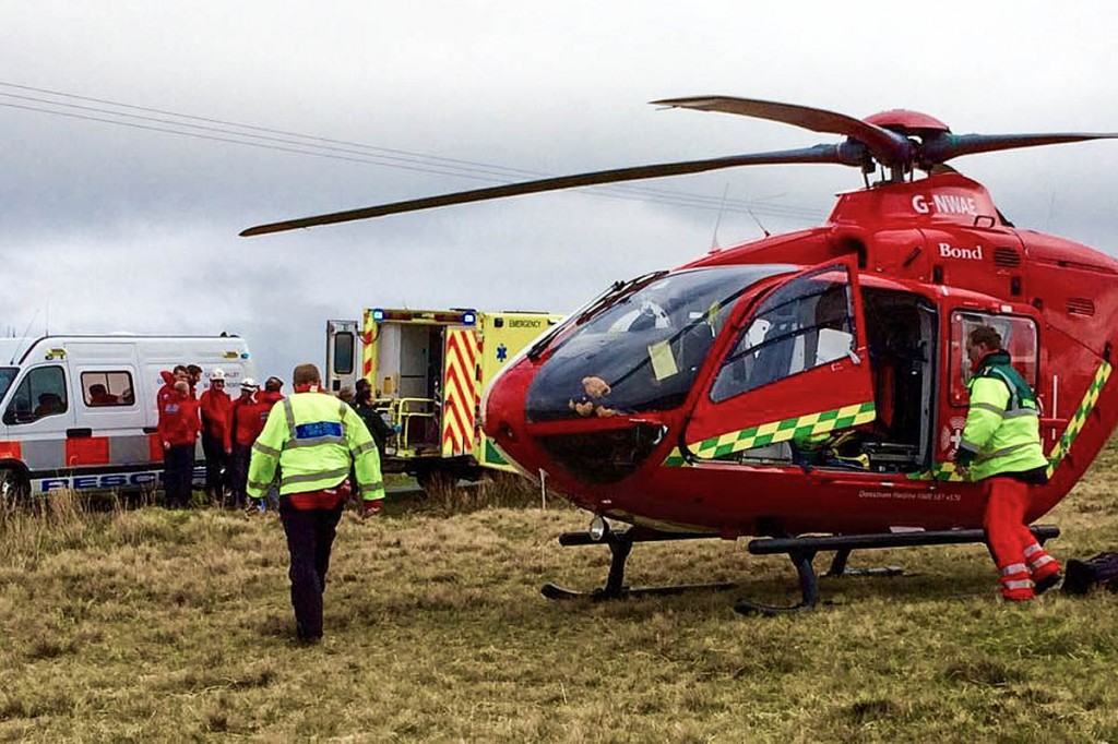 Rescuers at the scene with the air ambulance. Photo: CVSRT