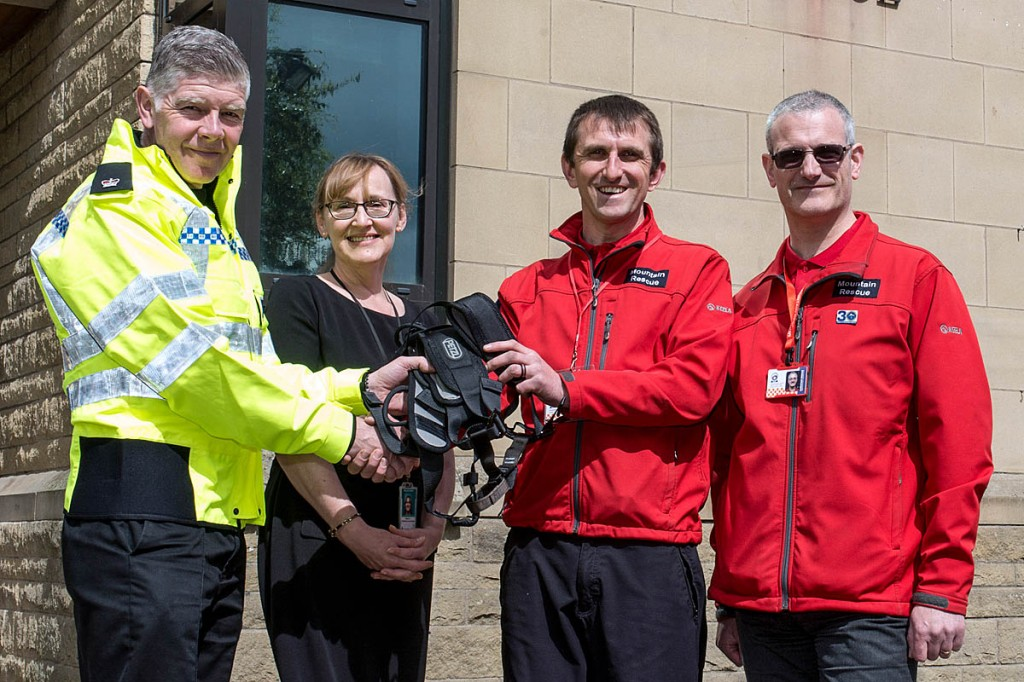 Superintendent Firth and partnership funding officer Lisa Raynor hand over the gear to Richard Smith and Jonathan Cole, right