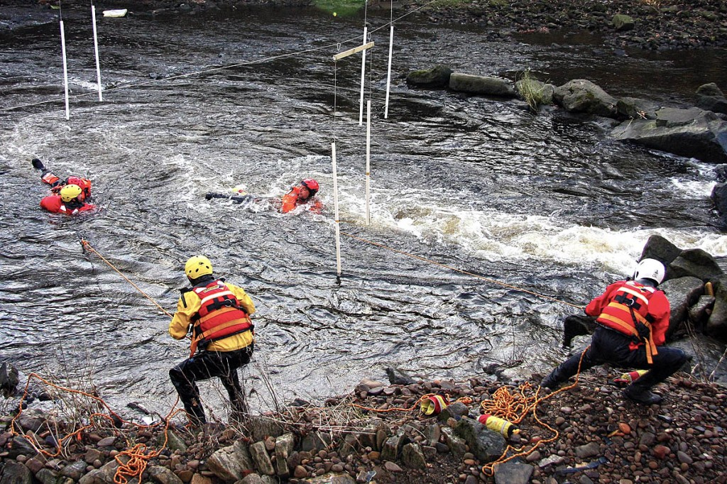 Rescue team members practise their swiftwater skills in the River Calder. Photo: Calder Valley SRT