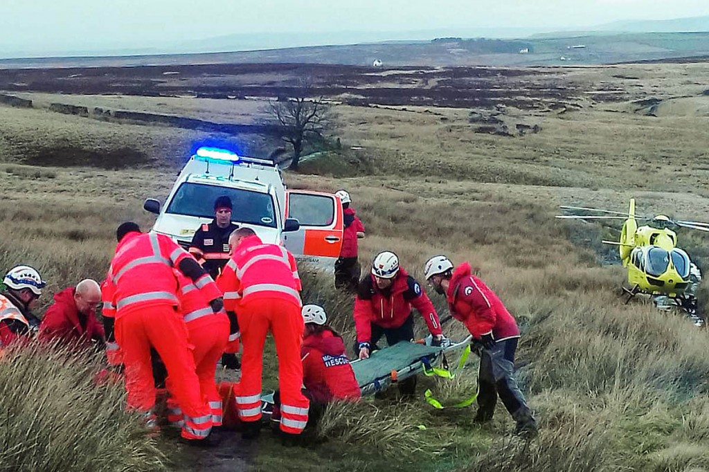 Rescue team members and air ambulance crew at the site of the team's 1,000th incident. Photo: Calder Valley SRT
