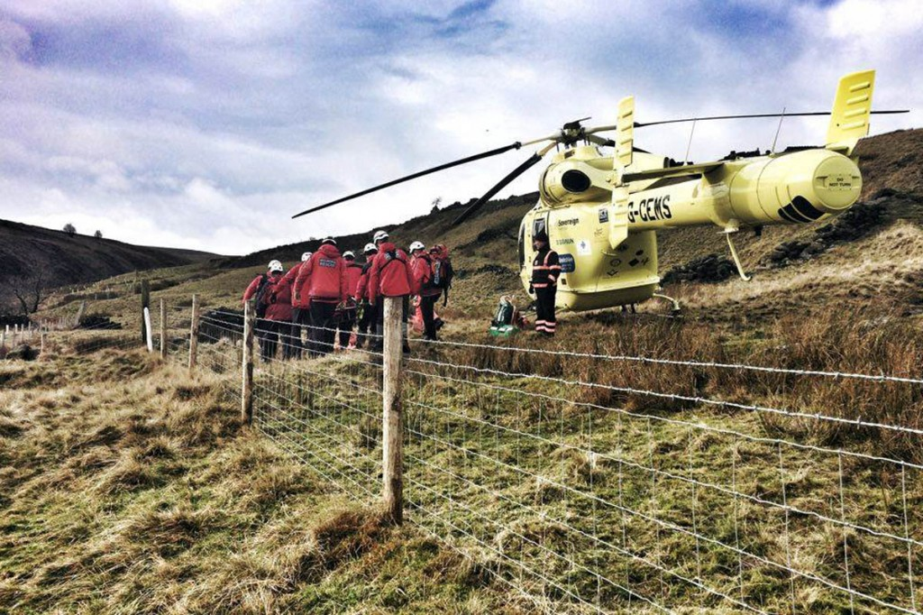 Calder Valley team members at the scene with the air ambulance on the hillside above Brontë Falls. Photo: Calder Valley SRT