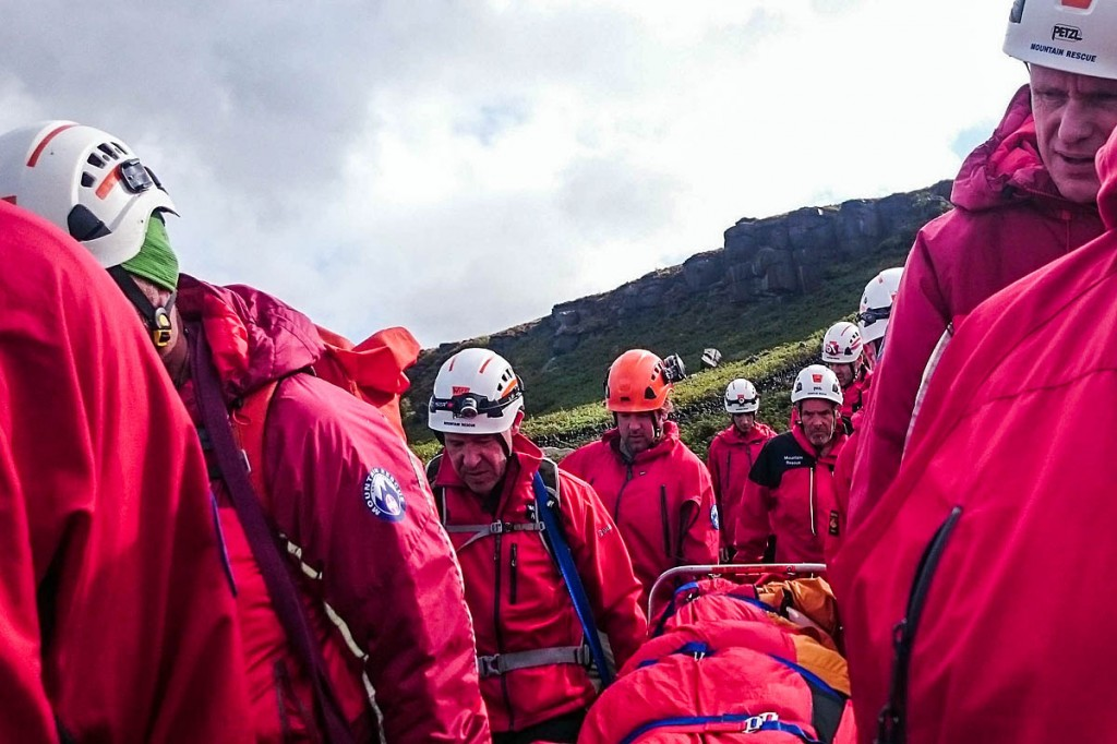 Rescuers stretcher the injured woman from the crag. Photo: Calder Valley SRT
