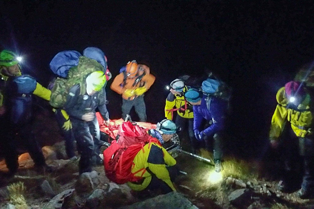 Team members with the injured man during the rescue. Photo: Cairngorm MRT