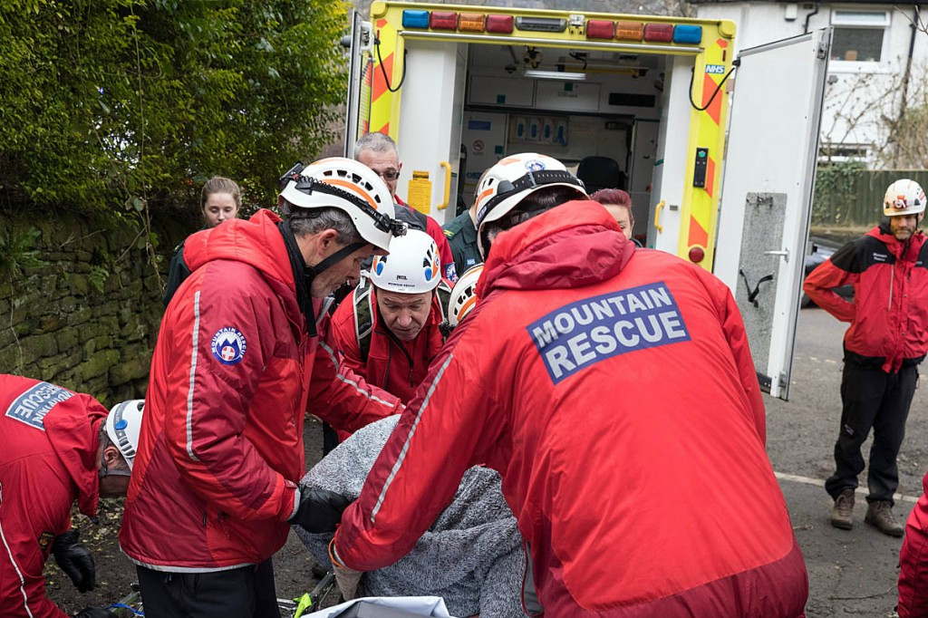 The injured walker is put into the ambulance. Photo: Bob Smith/grough