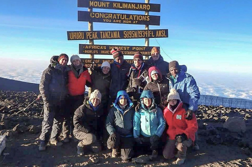 Drew Whitworth and companions on the summit of Kilimanjaro. Photo: Drew Whitworth