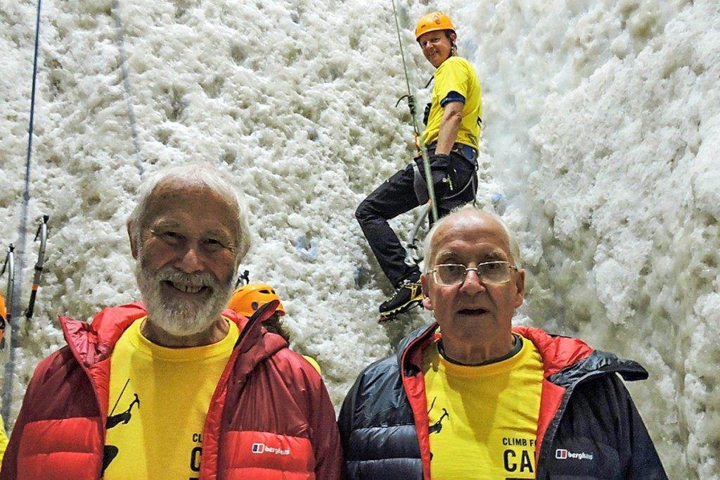 Sir Chris Bonington, left, and Doug Scott at the climb with Berghaus brand president Richard Leedham on the wall