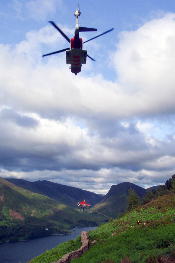 The injured walker is winched into the helicopter. Photo: Cockermouth MRT