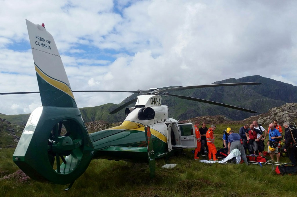 Rescuers and the air ambulance at the site near Hay Stacks. Photo: Cockermouth MRT
