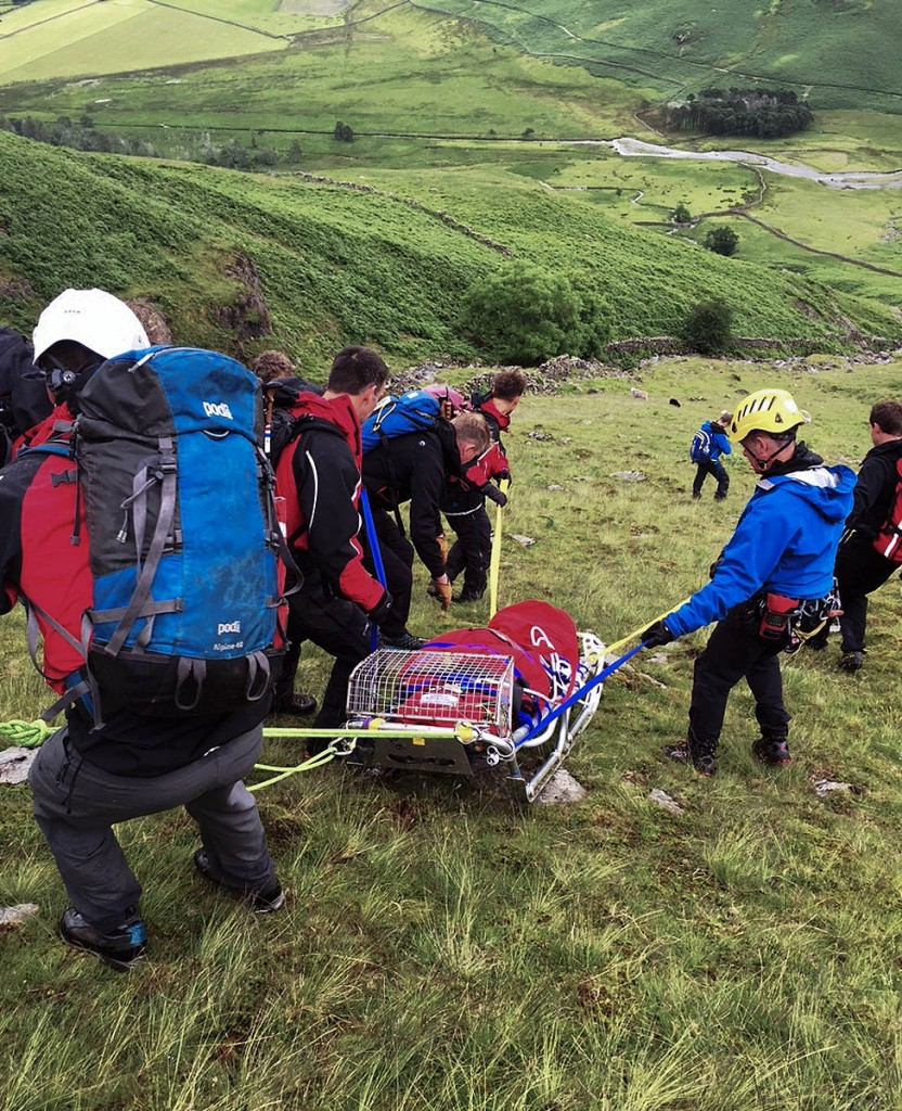 The injured walker is stretchered down the fell. Photo: Cockermouth MRT