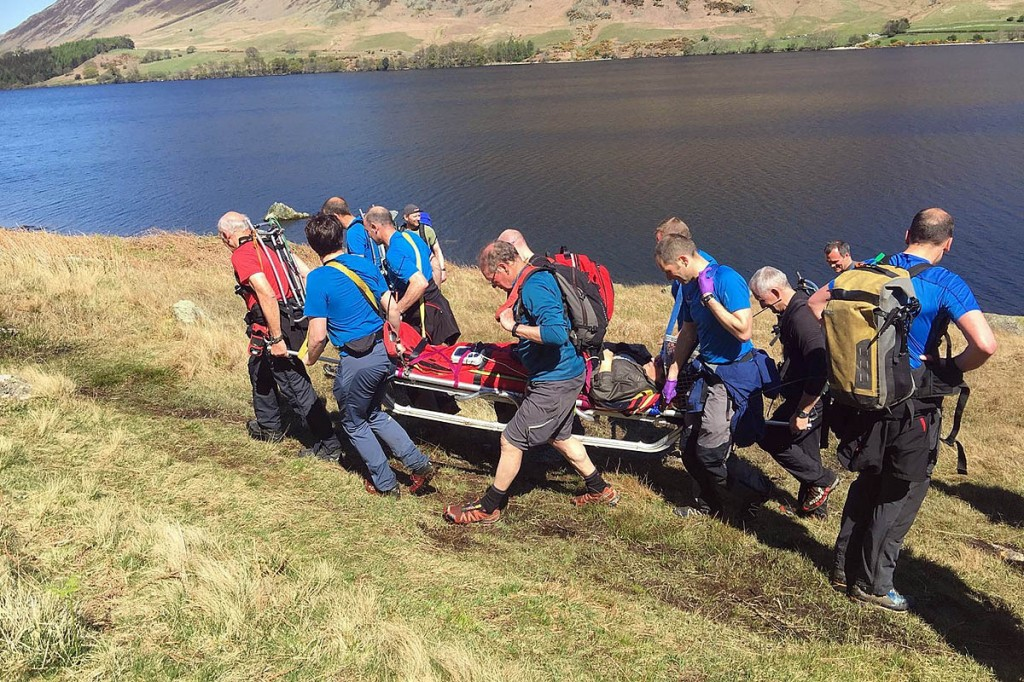 Team members stretcher the walker from the path alongside Crummock Water. Photo: Damian Jastrzebski/Cockermouth MRT