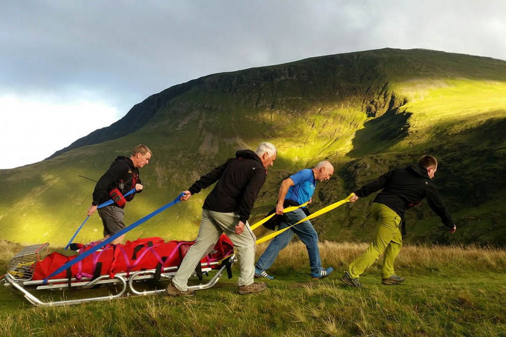 The injured walker is stretchered from the fell. Photo: Cockermouth MRT