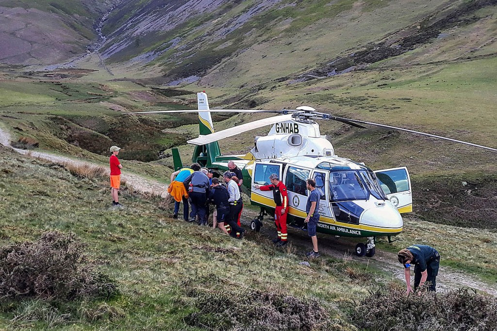 Rescuers with the air ambulance near the scene of the incident. Photo: Cockermouth MRT