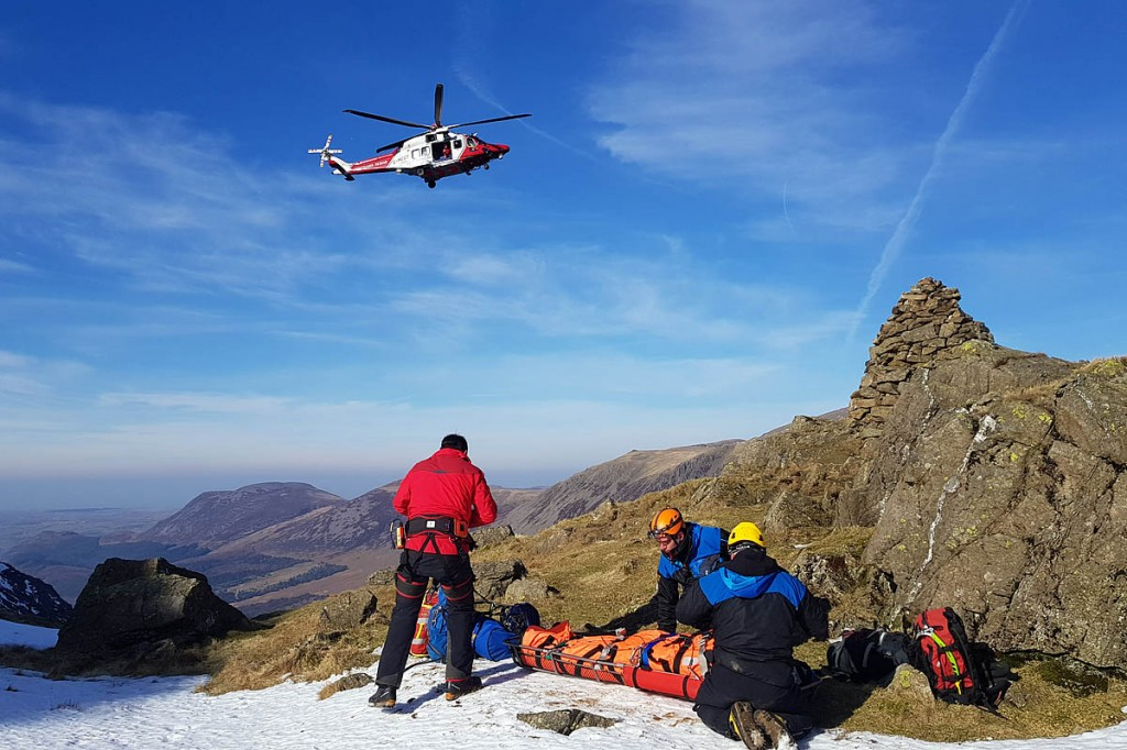 Rescuers and the helicopter at the site next to Robinson's Cairn. Photo: Cockermouth MRT