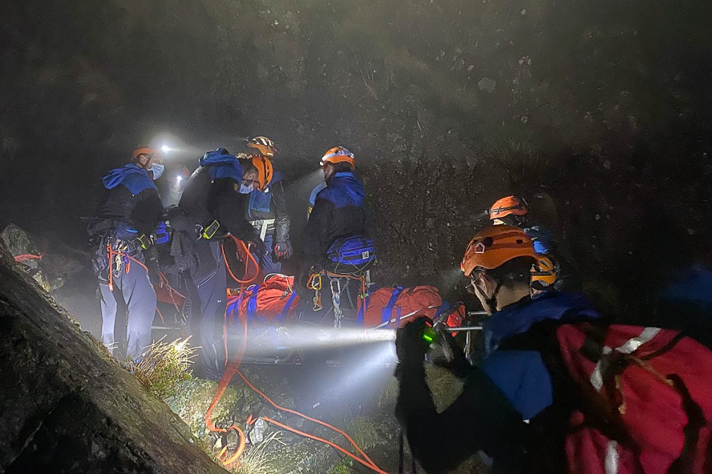 Team members tend to the injured walker. Photo: Cockermouth MRT