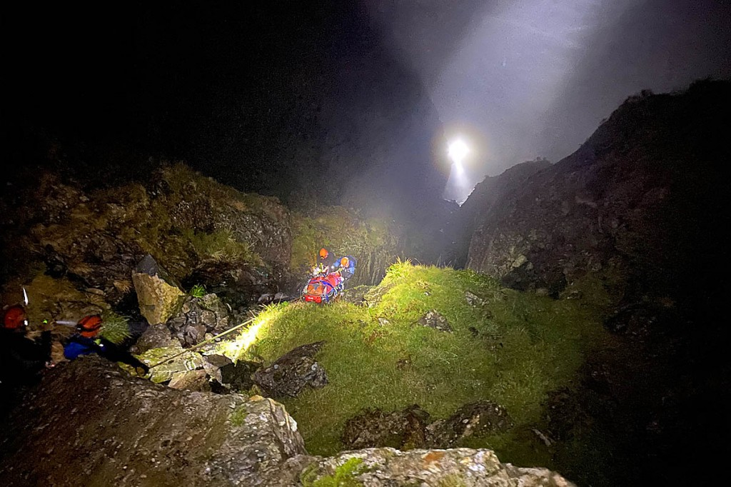 The injured man is lowered down the gully. Photo: Cockermouth MRT