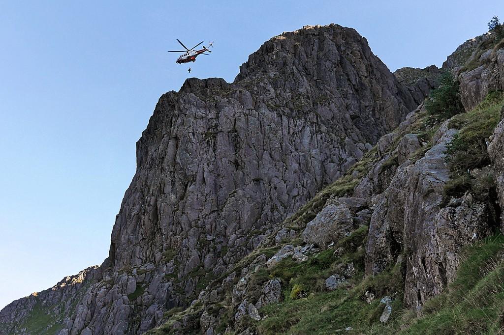 The Coastguard helicopter above the crag at Pillar Rock. Photo: Cockermouth MRT