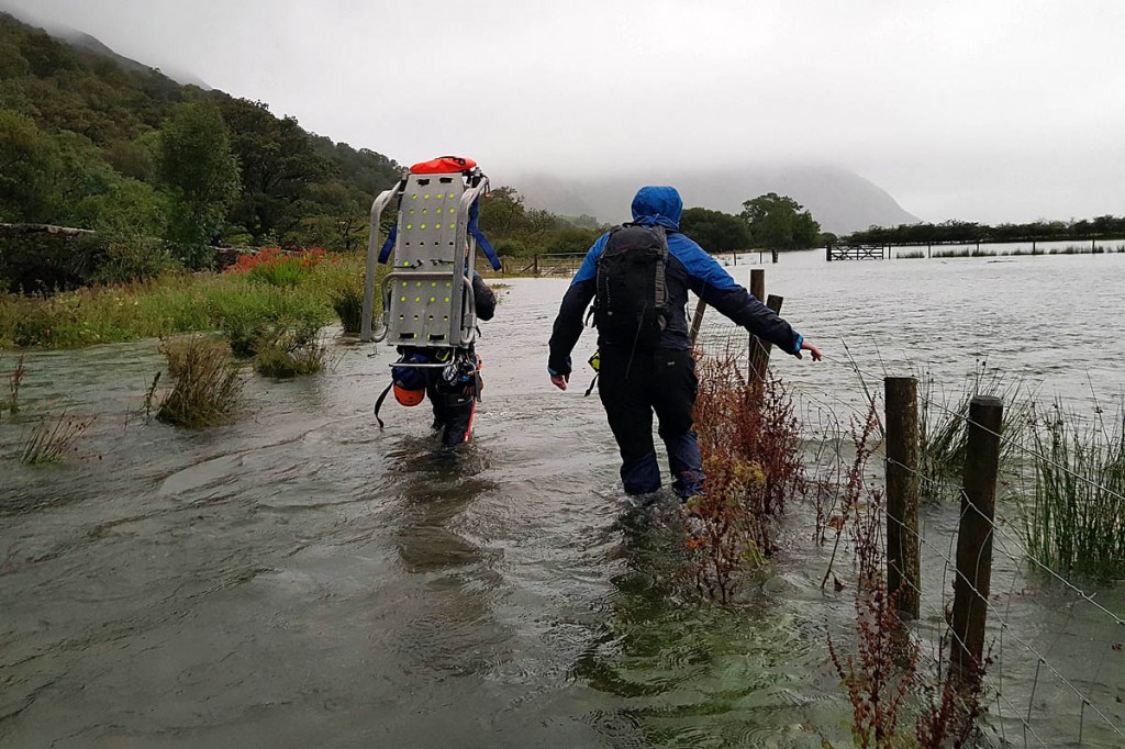 Rescuers had to contend with knee-deep water on their way to reach the walkers. Photo: Cockermouth MRT