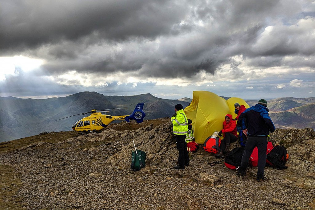 Rescuers in action on the summit of Robinson. Photo: Cockermouth MRT