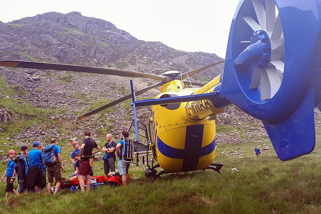 Rescuers with the air ambulance at Scarth Gap. Photo: Cockermouth MRT