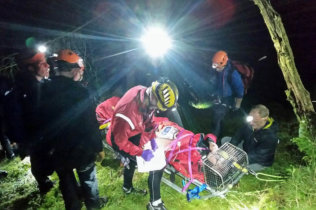 Rescuers with the injured walker. Photo: Cockermouth MRT