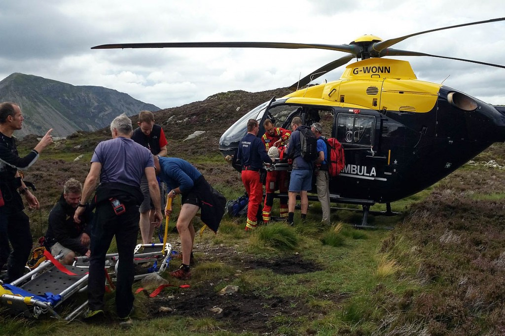 The injured woman is put into the helicopter by rescuers. Photo: Cockermouth MRT